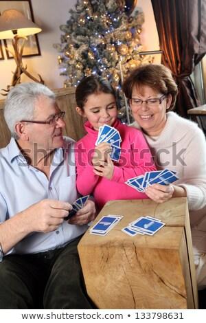 happy senior woman playing cards on christmas Stock photo © dolgachov