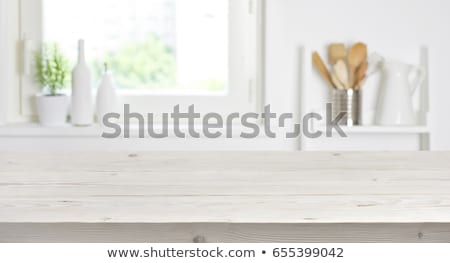 The surface of the wooden table on the background of flowers Stock photo © galitskaya