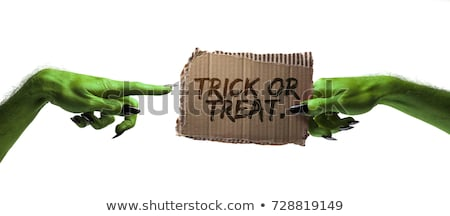 a zombie holding a happy halloween sign stock photo © solarseven