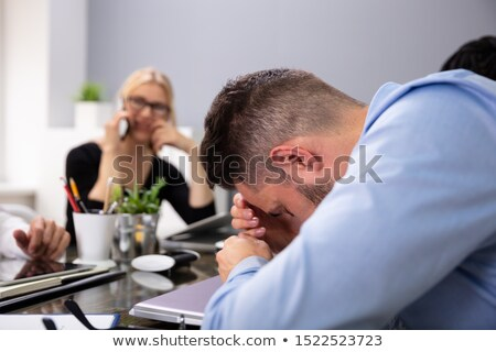 Businessman Getting Disturbed By Phone Calls Of His Partner Stock photo © AndreyPopov
