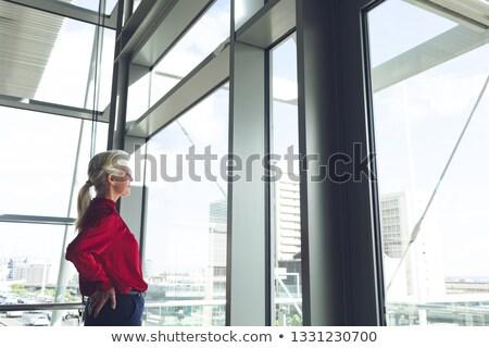 figyelmes · idős · nő · ablak · áll · otthon - stock fotó © wavebreak_media
