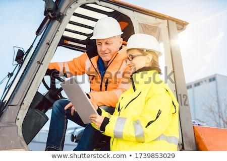 Supervisor instructing forklift driver what to work on next Stock photo © Kzenon