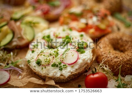 Composition of various homemade bagels sandwiches with sesame and poppy seeds Stock photo © dash