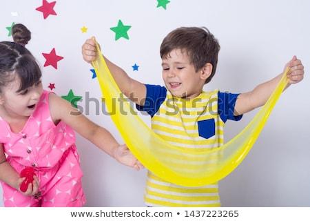 мальчика играет стороны игрушку слизь ребенка Сток-фото © galitskaya