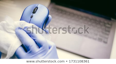 Office sanitizing wipe wiping mouse and mousepad with disinfecting wipes. Coronavirus COVID-19 sanit Stock photo © Maridav