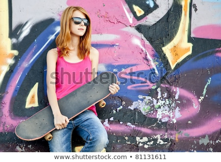 Girl near graffiti wall. Stock photo © Massonforstock