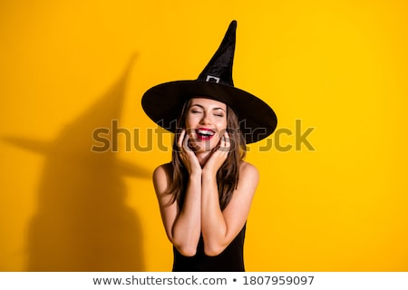 young witch with yellow eyes stock photo © elisanth