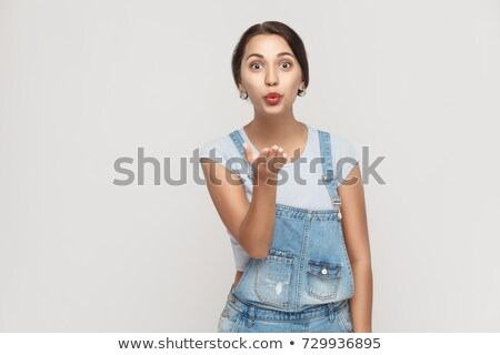 Woman Blowing a Kiss and Winking Stock photo © piedmontphoto