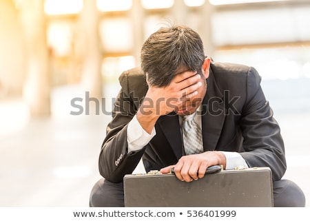 Depressed sad tired business man Stock photo © dundanim