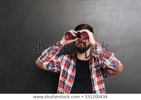 funny man with binoculars Stock photo © tiero