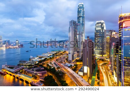 Hong Kong downtown at night with highrise buildings Stock photo © kawing921