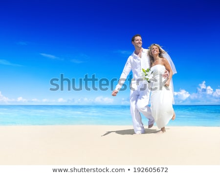 Bride and groom on idyllic tropical beach Stock photo © chrascina