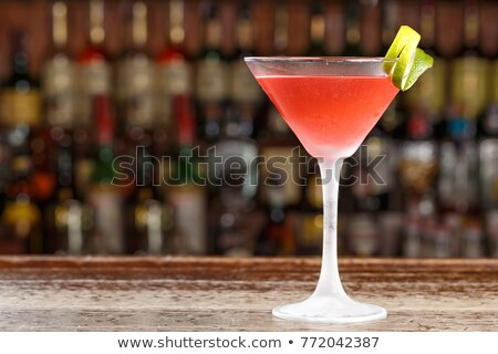 cosmopolitan cocktail with lemon garnish stock photo © 3523studio