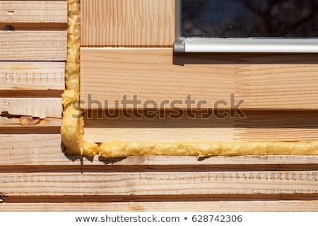 Close-up of Polyurethane foam filling gap in wooden construction Stock photo © Elmiko