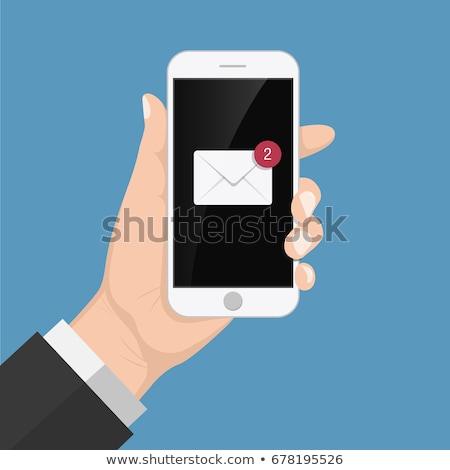 Mobiltelefon fogad sms férfi boldog technológia Stock fotó © adamr