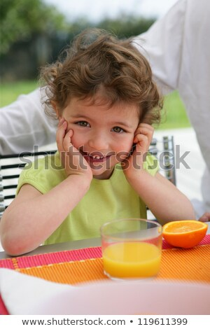 Child drinking a class of freshly squeezed orange juice Stock photo © photography33