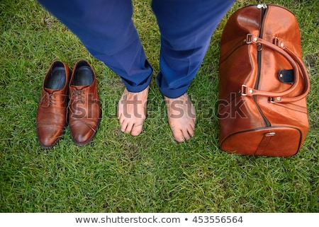 Man with travel bag standing on green lawn Stock photo © foto-fine-art