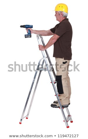 Labourer using a cordless screwdriver Stock photo © photography33