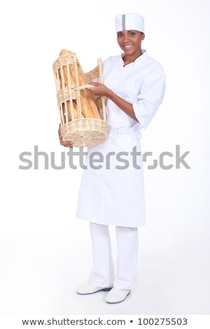 A baker showing off her bread Stock photo © photography33