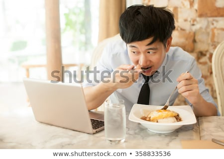 businessman eating chinese food at his desk stock photo © photography33