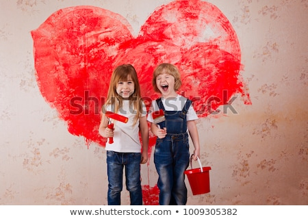 Children painting a wall red Stock photo © photography33