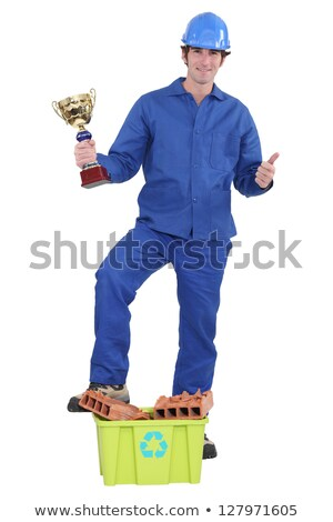 Bricklayer with award for recycling Stock photo © photography33