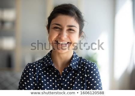 sorridente · feminino · trabalhador · de · escritório · cabelos · longos · retrato · negócio - foto stock © photography33