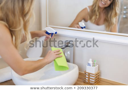 Young woman cleaning a bathroom's sink  Stock photo © wavebreak_media