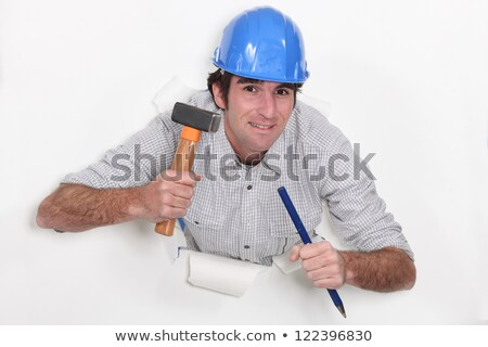 Man with hammer and chisel bursting through the background Stock photo © photography33
