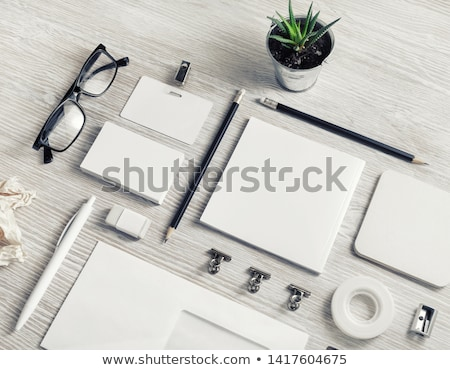 stack of crumpled papers on wooden table stock photo © inxti
