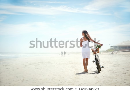 young woman with bike at the beach stock photo © photography33
