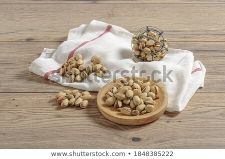 Foto stock: Closeup Shot Of Peanuts On A Wooden Table