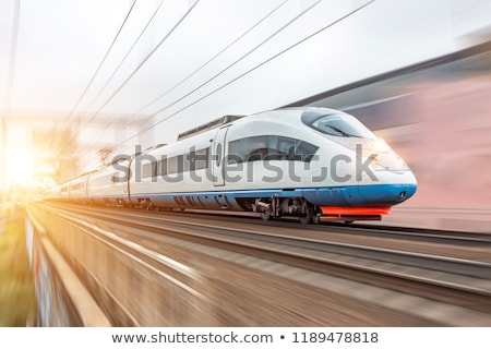 high speed train in movement on a railway station stock photo © abbphoto