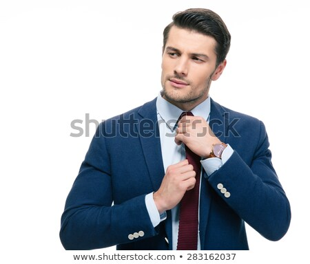 business man fixing his tie and looking away stock photo © feedough