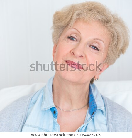 portrait of an attractive elegant senior woman relaxingand dream stock photo © hasloo