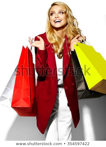 cute happy woman holding her shopping bags stock photo © get4net