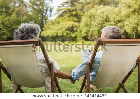 Olgun çift oturma güneş adam Stok fotoğraf © photography33