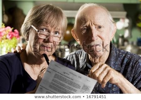 Senior couple at a grave Stock photo © Stocksnapper