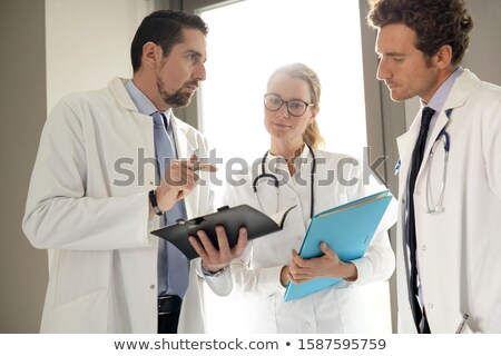 Doctor gives instructions Stock photo © w20er