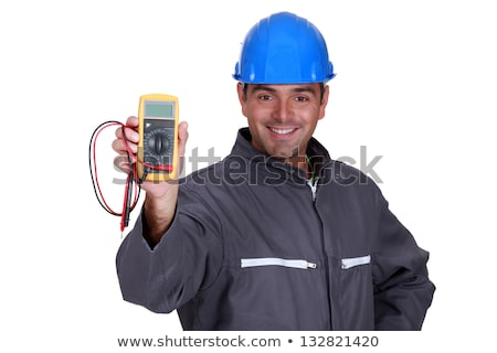happy electrician showing multimeter Stock photo © photography33