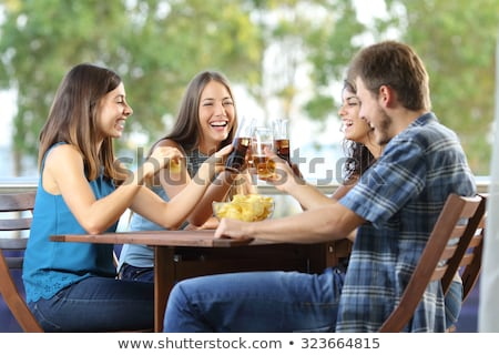 Vrienden drinken terras groep gelukkig Stockfoto © nenetus