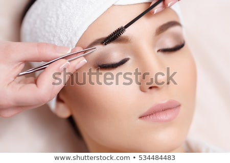 young beautiful woman eyebrow plucking tweezers eyes hair  Stock photo © juniart
