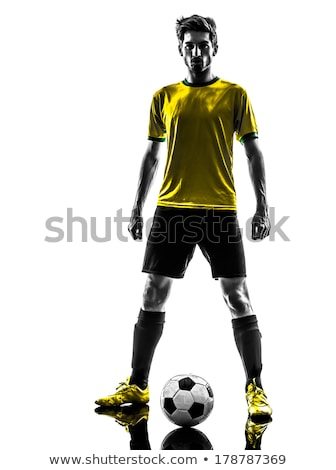 young soccer player poses proudly   Stock photo © meinzahn