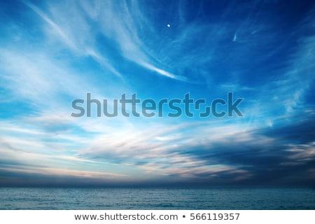 Mavi gökyüzü deniz manzarası bulutlu gökyüzü plaj yağmur Stok fotoğraf © jenbray