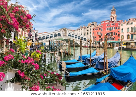 Venetian canal with gondola. Stock photo © 1Tomm