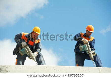 Two Workers with pneumatic hammer Stock photo © smuki