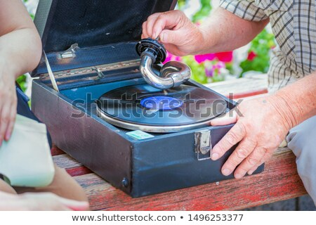 Man Starting Antique Phonograph Record Player Stock photo © feverpitch