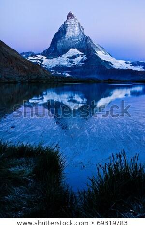 夜明け アルプス山脈 スイス 雲 雪 緑 ストックフォト © fisfra