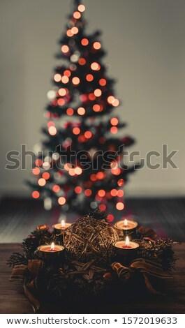 four decorated advent candles at black background stock photo © olandsfokus