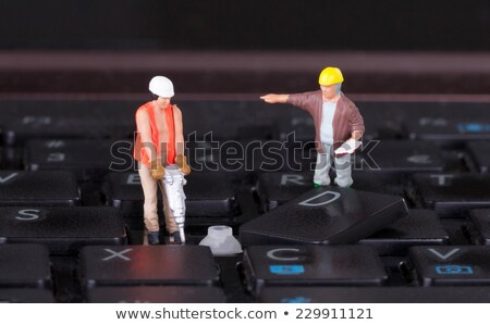 Miniature worker with drill working on keyboard Stock photo © michaklootwijk
